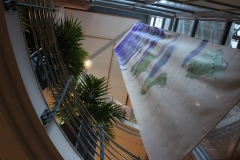 The flag hanging from the fifth floor looking up from the reception